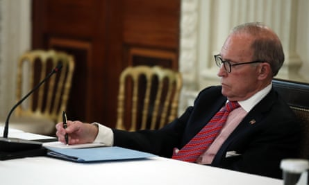 Larry Kudlow, White House chief economic adviser, takes notes as Donald Trump speaks about reopening the country on 29 April.