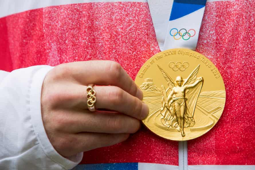 Matty Lee holds his gold medal, the olympic ring was a gift from Tom Daley just before the games started.
