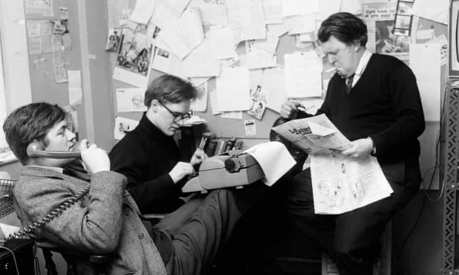 Christopher Booker, centre, Richard Ingrams, left, and Willie Rushton working on Private Eye in 1963.