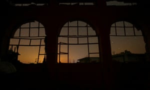 The night sky is seen through damaged windows in the rebel-controlled town of Binnish in Idlib provinc