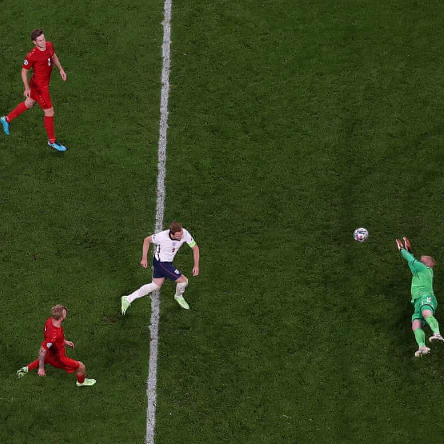 Harry Kane of England scores past Kasper Schmeichel of Denmark from the rebound of a missed penalty.