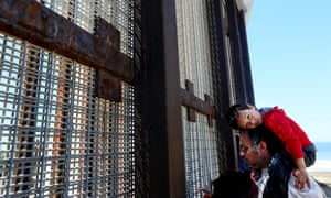 A family meets loved ones at the border fence. The border patrol do not publicize the place as a meeting point.