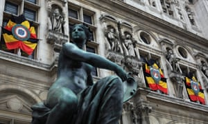 Belgium flags ornate the facade of the Paris town hall