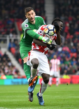 Mame Biram Diouf of Stoke City clashes with Hugo Lloris of Tottenham Hotspur on his way to scoring the equaliser. Spurs won the points with a 2-1 away win at the Bet365 Stadium.