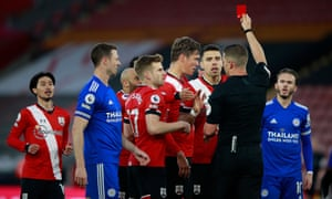 Southampton's Jannik Vestergaard is sent off for foul on Jamie Vardy of Leicester City