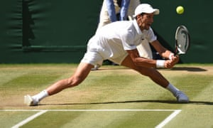 Novak Djokovic stretches to return the ball. The Serb had the physical edge on his opponent after Anderson's marathon semi-final.