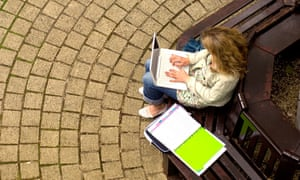 A student in the quad of the Continuing Education building at Oxford University.
