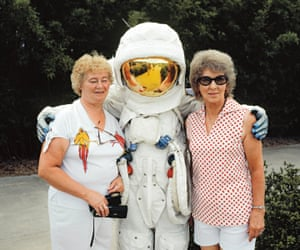 Tourists posing with an astronaut in an Apollo spacesuit at the Kennedy Space Center in Orlando. Two million people visited the Center in 1981, making it Florida's fourth most popular tourist destination