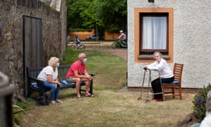 A socially distanced family visit in the garden of Eskgreen care home in Musselburgh, East Lothian