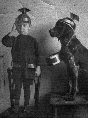 Six-year-old Stefan on 20 August 1914 wearing an Austrian helmet and uniform given to him as a gift. He is pictured with his pet dog in pre-independence Poland