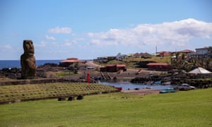 Moai statue and fishing village on Easter Island.