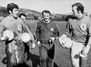 Docherty puts goalkeepers Bobby Clarke and Bob Wilson through their paces in training.