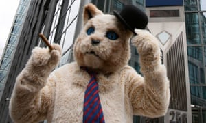 A protester in a 'fat cat' suit stands outside RBS in London, 2012
