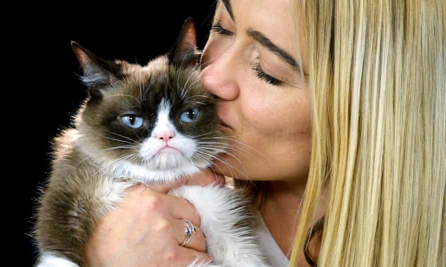 The late YouTube star Grumpy Cat with her owner Tabatha Bundesen