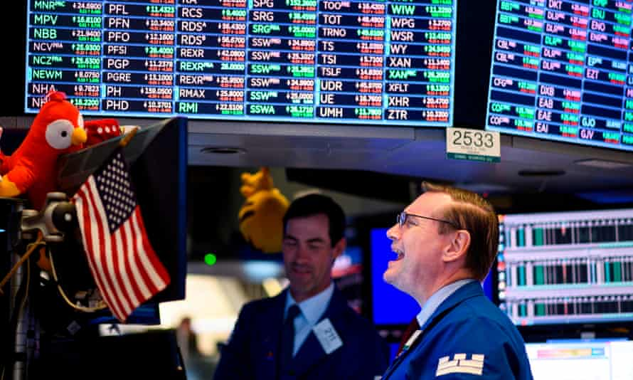 Traders work before the closing bell at the New York Stock Exchange on 14 August as stocks plummeted about 800 points.