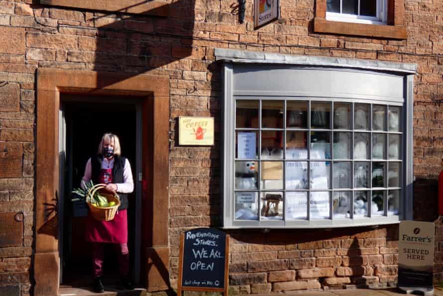 Shop exterior with volunteer