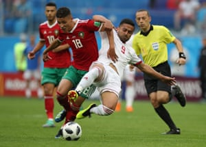 Morocco's Amine Harit is tackled by Omid Ebrahimi.