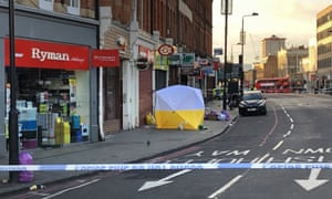 A Police forensic tent is erected at the scene of a fatal stabbing in Camden in London.