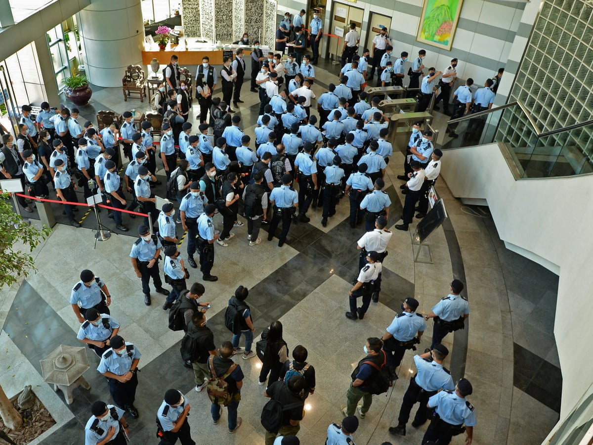 Hong Kong police arrest editor-in-chief of Apple Daily newspaper in raids |  Hong Kong | The Guardian