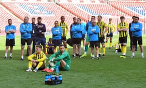 AFC Fylde's players sit dejected on the Wembley turf after their 3-0 defeat to Salford in the National League play-off final.