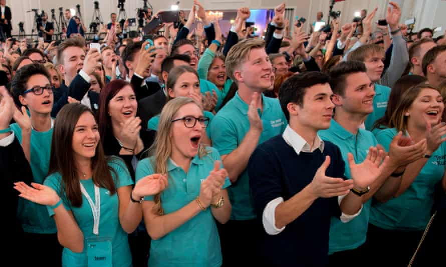 Supporters of Kurz react to the first results after the elections in Vienna on Sunday.