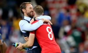 Gareth Southgate celebrates with Jordan Henderson after beating Colombia.