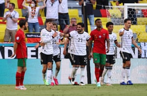 Germany's Kai Havertz and teammates celebrate after Portugal's Ruben Dias scores an own goal and equaliser for Germany.