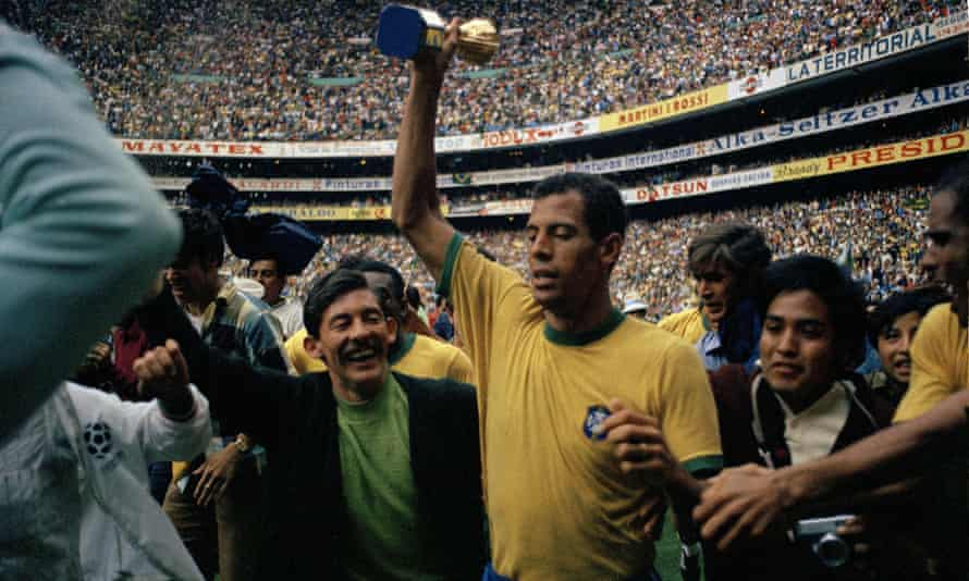 Carlos Alberto holds up the golden Jules Rimet Trophy, after his team defeated Italy in the 1970 World Cup final at Azteca Stadium, in Mexico City