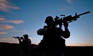 US Navy Seals training for desert combat.