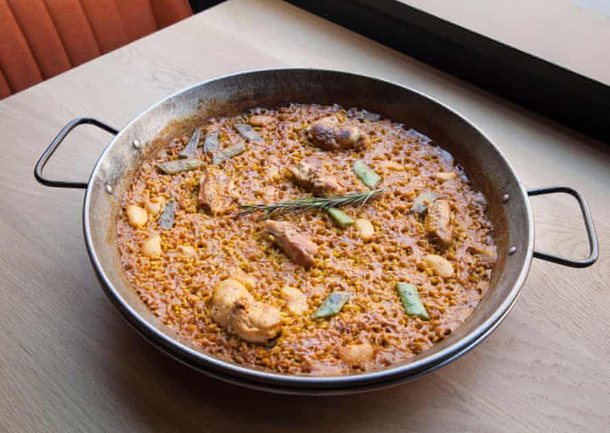 Arros' paella with rabbit and artichoke appears to be entirely 'socarrat'.