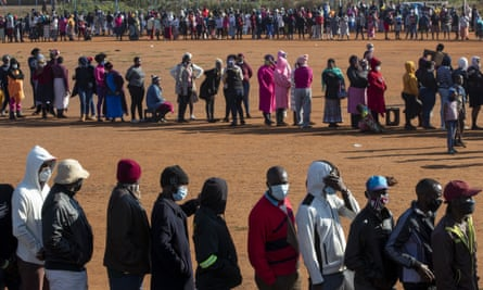 People queuing to receive food parcels in Pretoria, South Africa, in May