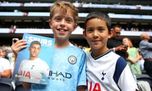 Buddies: Young City and Spurs supporters enjoy having their picture taken.