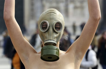 A model representing Peta wears a gas mask to demonstrate against the use of fur at Milan fashion week.