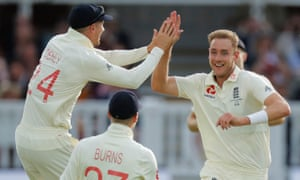 Stuart Broad celebrates taking the wicket of David Warner with Rory Burns and Joe Denly.