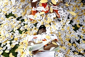 Travis Etienne of the Clemson Tigers celebrates while covered in confetti