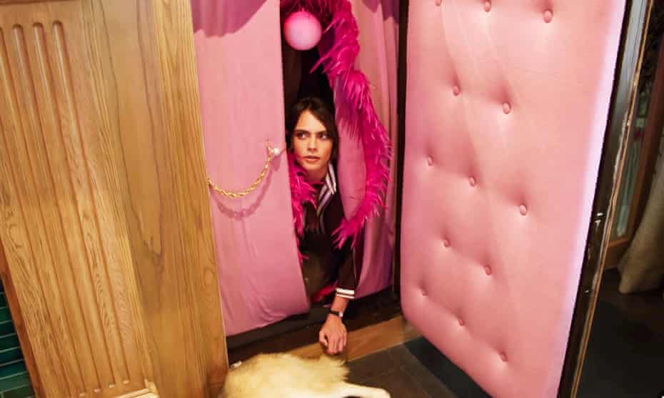 Cara Delevingne emerges from her vagina tunnel in the Architectural Digest Open Homes series