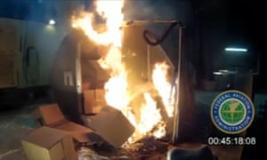 Frame from a Federal Aviation Administration (FAA) video showing a fire in a cargo container of 5,000 rechargeable lithium-ion batteries.