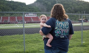 A mother watches her sons at football practice. Local sports, in particular football, are a large part of Prestonsburg