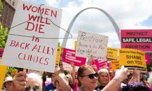 Protesters rally in support of Planned Parenthood and pro-choice in St Louis, Missouri, on 30 May.