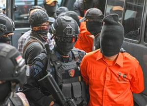 Arrested terror suspects are escorted to a news conference in Jakarta