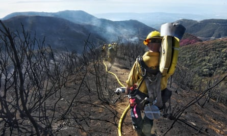 Firefighters in Santa Barbara County work their way through hillsides left charred by California's largest-ever wildfire.