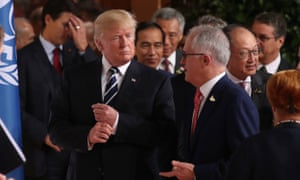Trump and Turnbull in suits talking at an event