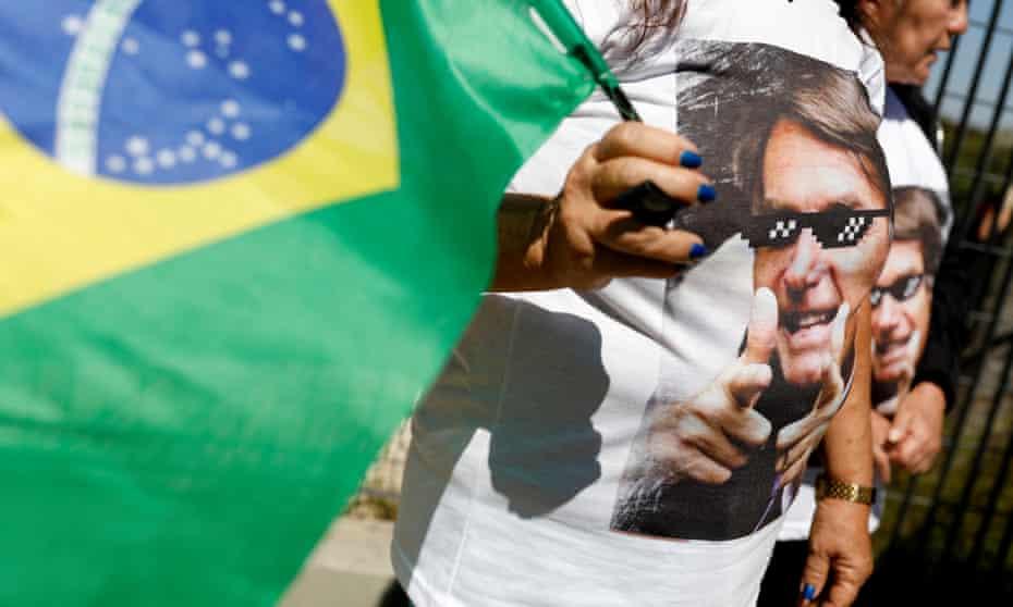 A supporter of Jair Bolsonaro outside the hospital.