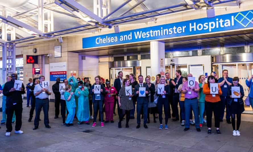 Staff at Chelsea and Westminster Hospital during Clap for Carers, 9 April 2020: 'The same day Dominic Raab encouraged us all to clap for workers risking their lives, the government restated that some of them soon won't be allowed in the country.'