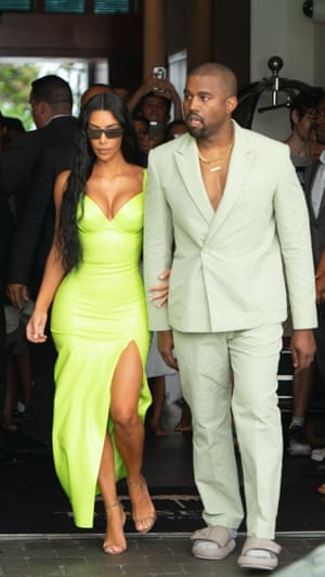 'The swagger of streetwear meets the more traditional world of tailoring' … Kanye West in a mint green, oversized Louis Vuitton double-breasted suit with no shirt and slide sandals