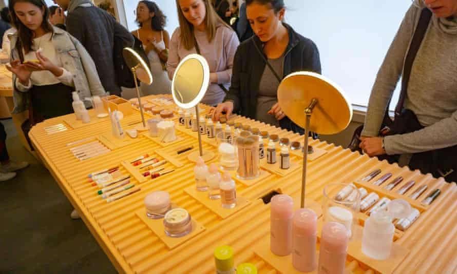 'We think about hospitality rather than traditional sales': customers trying on makeup crowd a Glossier pop-up.