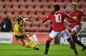 Arsenal's Lisa Evans has a shot on goal.