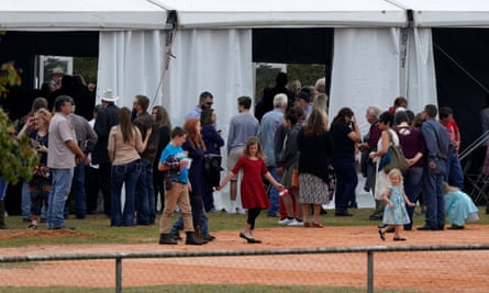 An overflow crowd leaves the First Baptist church of Sutherland Springs worship service on a ballfield, the first service since the attack.