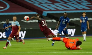 West Ham's Michail Antonio is challenged by Chelsea keeper Kepa Arrizabalaga.