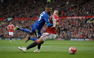 Riyad Mahrez appears to be tripped by Manchester United's Marcus Rojo but no penalty is given